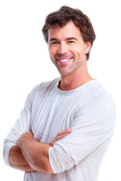 man with arm crossed smiling